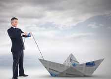 Businessman pulling paper boat Stock Photos