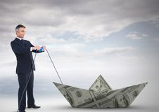 Businessman pulling paper money dollar boat Stock Photography