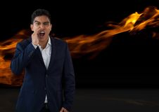Businessman shouting with fire. Digital composite of Businessman shouting with fire Stock Photos