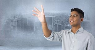 Businessman touching air in front of city Royalty Free Stock Photo