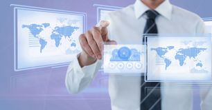 Businessman touching and interacting with technology interface panels. Digital composite of Businessman touching and interacting with technology interface panels Royalty Free Stock Images