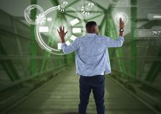 Businessman touching interface on green bridge. Digital composite of Businessman touching interface on green bridge Royalty Free Stock Images