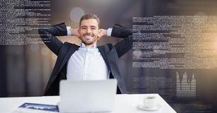 Businessman working on laptop with screen text interface. Digital composite of Businessman working on laptop with screen text interface Stock Photography