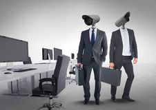 Businessmen with CCTV head at office. Digital composite of Businessmen with CCTV head at office Stock Photo