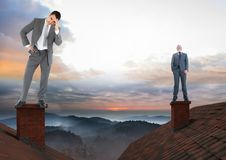 Businessmen standing on Roofs with chimney and colorful landscape Royalty Free Stock Photos
