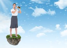 Businesswoman with binoculars on floating rock platform in sky. Digital composite of Businesswoman with binoculars on floating rock platform in sky Royalty Free Stock Photo