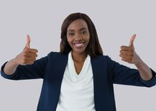 businesswoman smiling with thumbs up royalty free stock photography