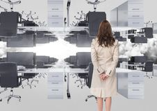 businesswoman standing in inverted office in the clouds Stock Images