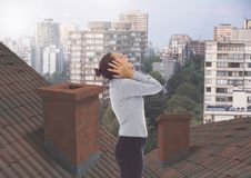 Businesswoman standing on Roofs with chimney contrasting with apartment blocks. Digital composite of Businesswoman standing on Roofs with chimney contrasting Royalty Free Stock Photography