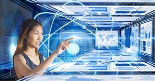 Businesswoman touching and interacting with technology interface panels. Digital composite of Businesswoman touching and interacting with technology interface Royalty Free Stock Image