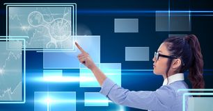 Businesswoman touching and interacting with technology interface panels. Digital composite of Businesswoman touching and interacting with technology interface Stock Photos
