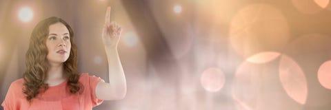 Businesswoman touching light glow. Digital composite of Businesswoman touching light glow stock image