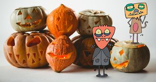 Cartoon Monsters standing with halloween pumpkins Royalty Free Stock Photography