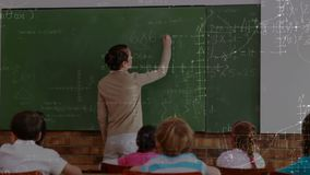 Teacher writing on chalkboard. Digital composite of Caucasian female teacher writing on chalkboard in classroom full of students. Mathematical formulas moving on stock footage