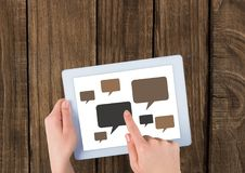 Chat icons on tablet with hands Royalty Free Stock Photos