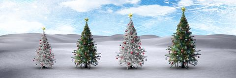 Christmas trees in winter landscape with blue sky. Digital composite of Christmas trees in winter landscape with blue sky Stock Images