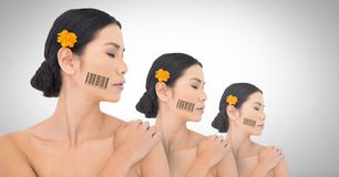 Clone Asian women in row with barcodes. Digital composite of Clone Asian woman in row with barcodes Stock Images