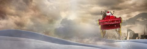Cloudy sky and snow landscape city transition of Santa`s sleigh and reindeer`s. Digital composite of Cloudy sky and snow landscape city transition of Santa`s Royalty Free Stock Images