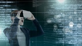 Code and technology interface with virtual reality headset on businesswoman stock video footage