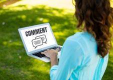 Comment text and chat graphic on laptop screen with woman Stock Image