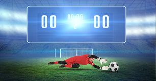 Composite image of soccer goalkeeper and ball and digital score royalty free stock images