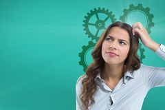 Confused woman scratching her head looking up with cogs stock image