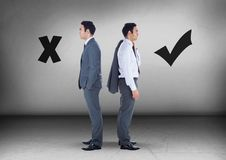 Correct right and wrong symbols with Businessman looking in opposite directions Royalty Free Stock Images