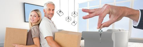 Couple holding boxes in 3d living room. Digital composite of couple holding boxes in 3d living room Stock Photos
