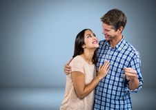 Couple Holding key in front of vignette Stock Photo
