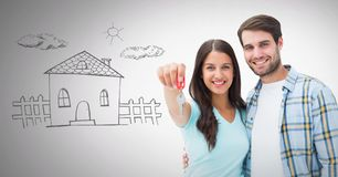 Couple Holding key with home drawing in front of vignette. Digital composite of Couple Holding key with home drawing in front of vignette Royalty Free Stock Images