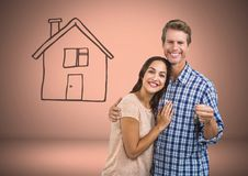 Couple Holding key with house drawing in front of vignette. Digital composite of Couple Holding key with house drawing in front of vignette Stock Images