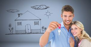 Couple Holding key with house home drawing in front of vignette Stock Images