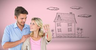 Couple Holding key house home drawing in front of vignette Stock Photo