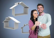 Couple Holding key with house icons in front of vignette Stock Image