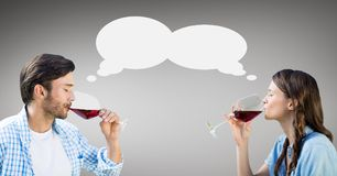 Couple with speech bubble drinking wine against grey background Stock Images