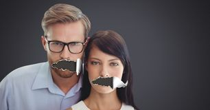Couple with torn paper on mouths. Digital composite of Couple with torn paper on mouths Royalty Free Stock Image