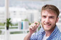 Customer care representative man against office background Stock Photos