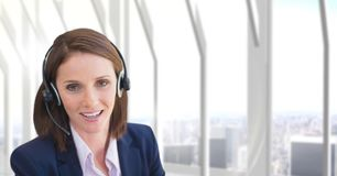 Customer care representative woman against city background Royalty Free Stock Images