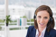 Customer care representative woman against office background Stock Photography
