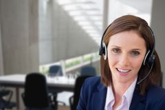 Customer care representative woman against office background Stock Images