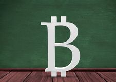 3D Bitcoin icon on floor in room with education blackboard. Digital composite of 3D Bitcoin icon on floor in room with education blackboard Royalty Free Stock Photography