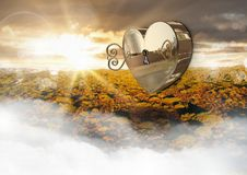 3D Heart box Key floating over landscape sunset Royalty Free Stock Image