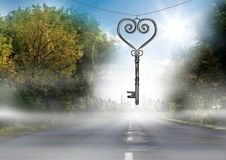 3D Heart Key floating over road Stock Photo
