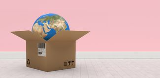 Composite 3d image of digital composite image of globe in brown cardboard box. Digital composite 3D image of globe in brown cardboard box against pink wall by Royalty Free Stock Photography