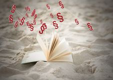 3D Section symbol icons and book in sand. Digital composite of 3D Section symbol icons and book in sand Stock Photography