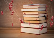 3D Section symbol icons and books stacked up. Digital composite of 3D Section symbol icons and books stacked up Royalty Free Stock Photos