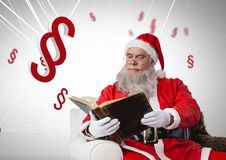3D Section symbol icons and Santa with book at Christmas. Digital composite of 3D Section symbol icons and Santa with book at Christmas Royalty Free Stock Image