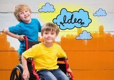 Disabled boy in wheelchair with friend with colorful idea clouds. Digital composite of Disabled boy in wheelchair with friend with colorful idea clouds Royalty Free Stock Image