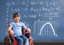 Disabled girl in wheelchair in front of blackboard with math equations stock photo