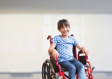 Disabled girl in wheelchair in school stock images